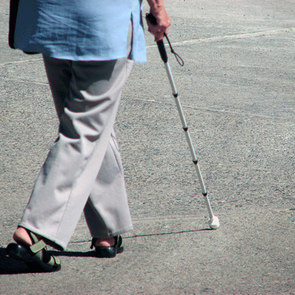 woman walking with white cane